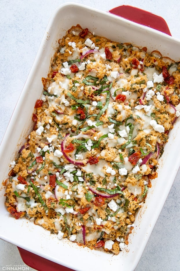 overhead shot of Mediterranean quinoa casserole sprinkled with feta and basil