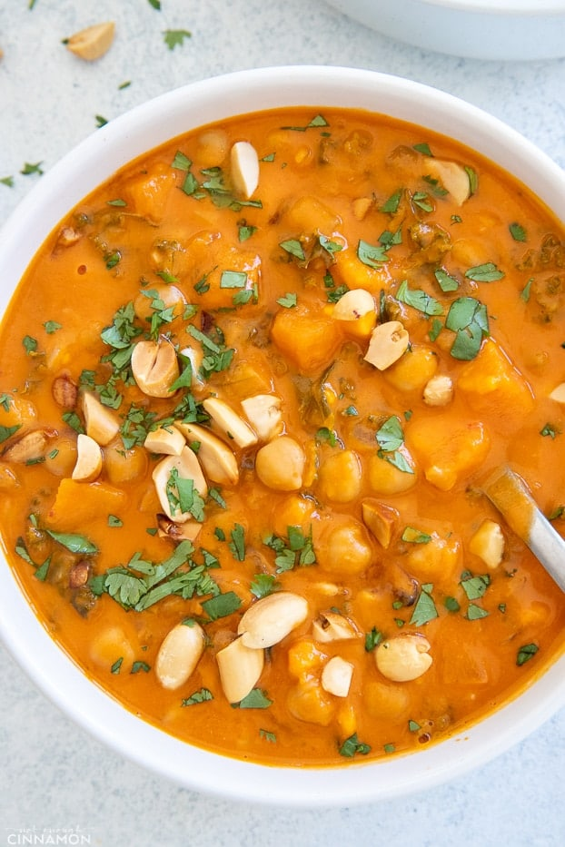 a bowl of healthy vegan West African Peanut Soup with a spoon