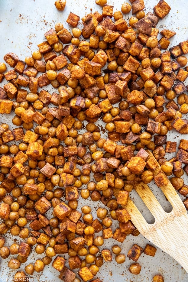 overhead shot of roasted sweet potatoes and chickpeas with spices