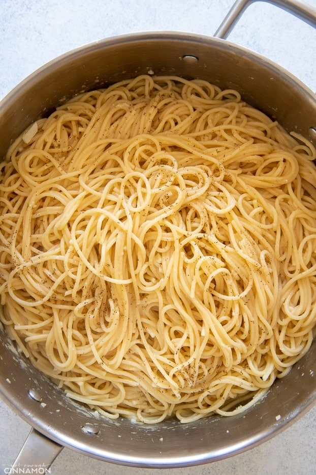 al dente pasta tossed in a pot with garlic butter and lemon juice to make lemon pasta