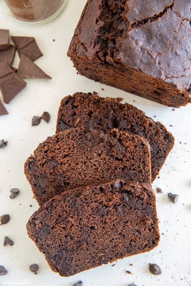 overhead shot of three slices of moist gluten-free chocolate zucchini bread with chocolate chips