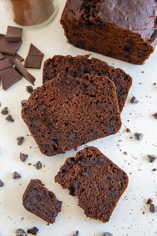a sliced loaf of gluten-free double chocolate zucchini bread with chocolate chips