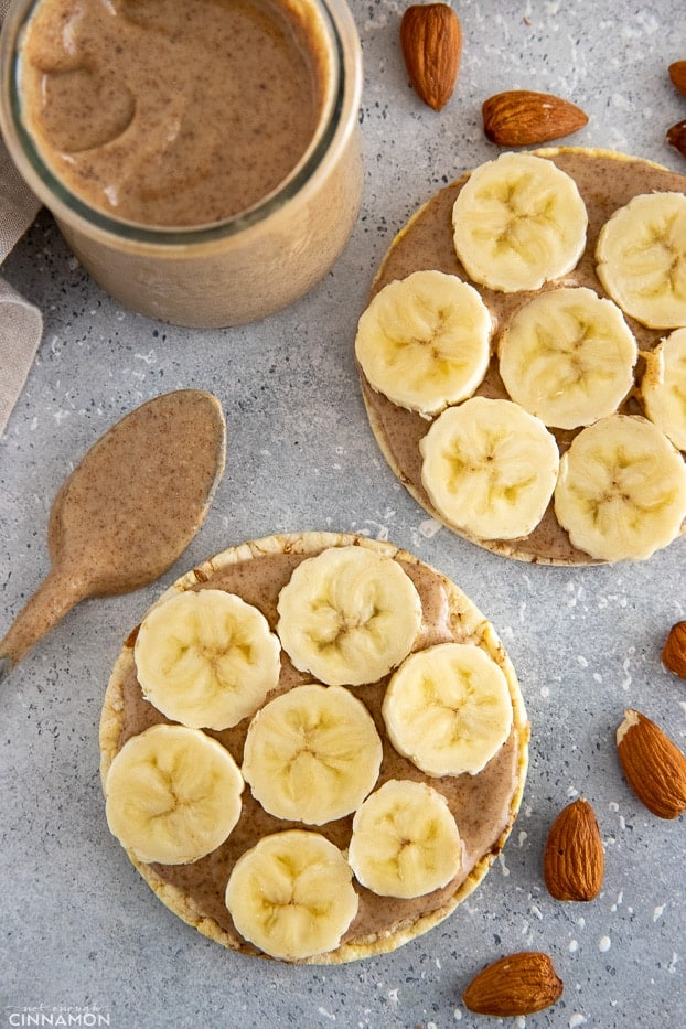 overhead shot of rice wafers topped with almond butter and banana slices