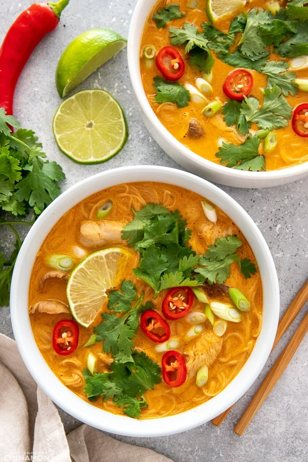 overhead shot of Thai Red Curry Chicken Noodle Soup with coconut milk