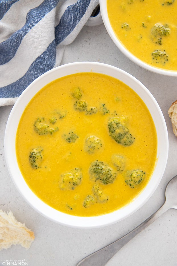 two bowls of easy vegan broccoli cheese soup made with cashew cream