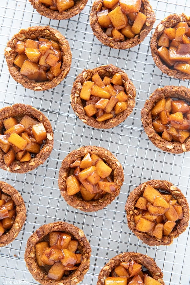 healthy homemade apple crisp cookie cups cooling on a cooling rack