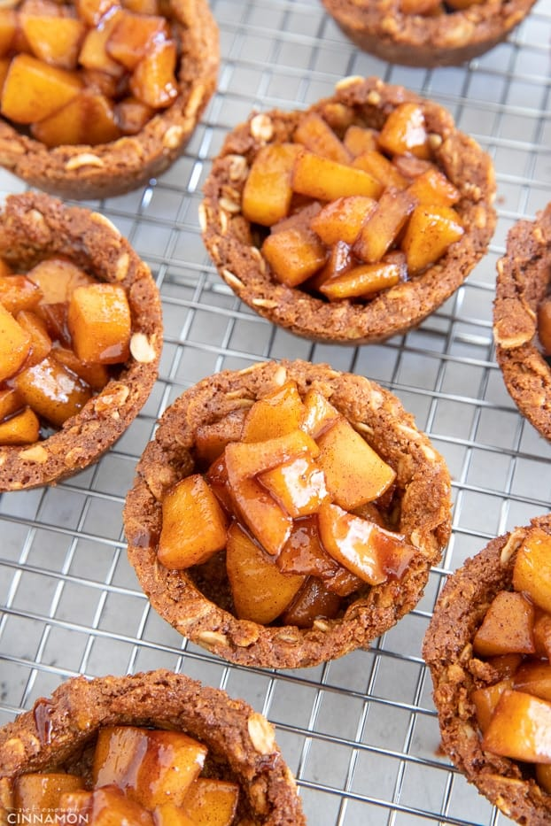 overhead shot of apple crisp cookie cups chilling on a cooling rack