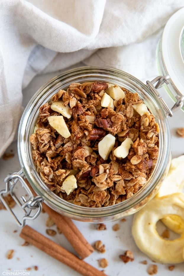 overhead shot of a mason jar with healthy apple pie granola