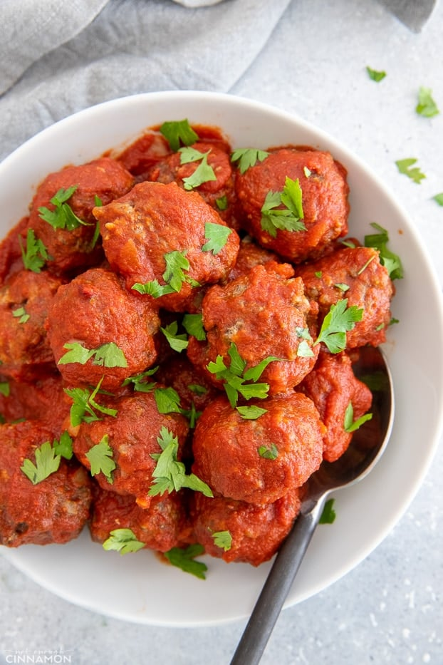overhead shot of a serving of healthy slow cooker beef meatballs served with tomato sauce
