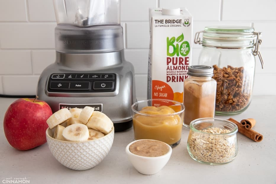 ingredients used for making apple pie smoothie bowls on a kitchen counter