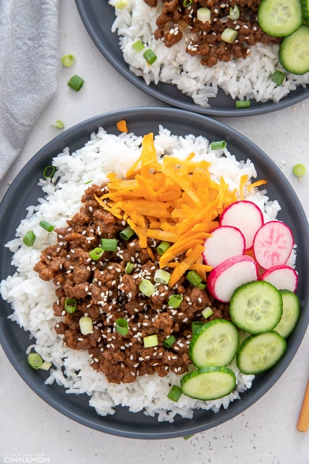 overhead shot of a healthy Korean Ground Beef Bowl served with assorted vegetables