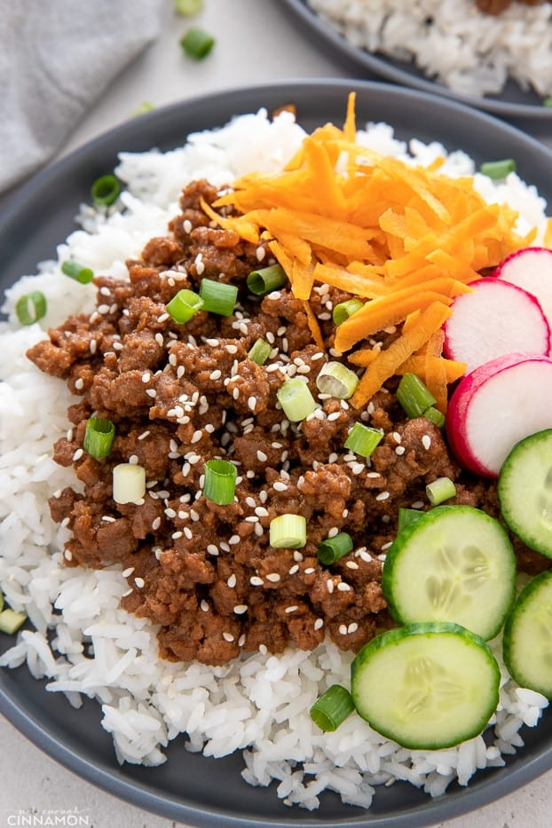 side view of Korean Beef Bowls topped with sesame seeds