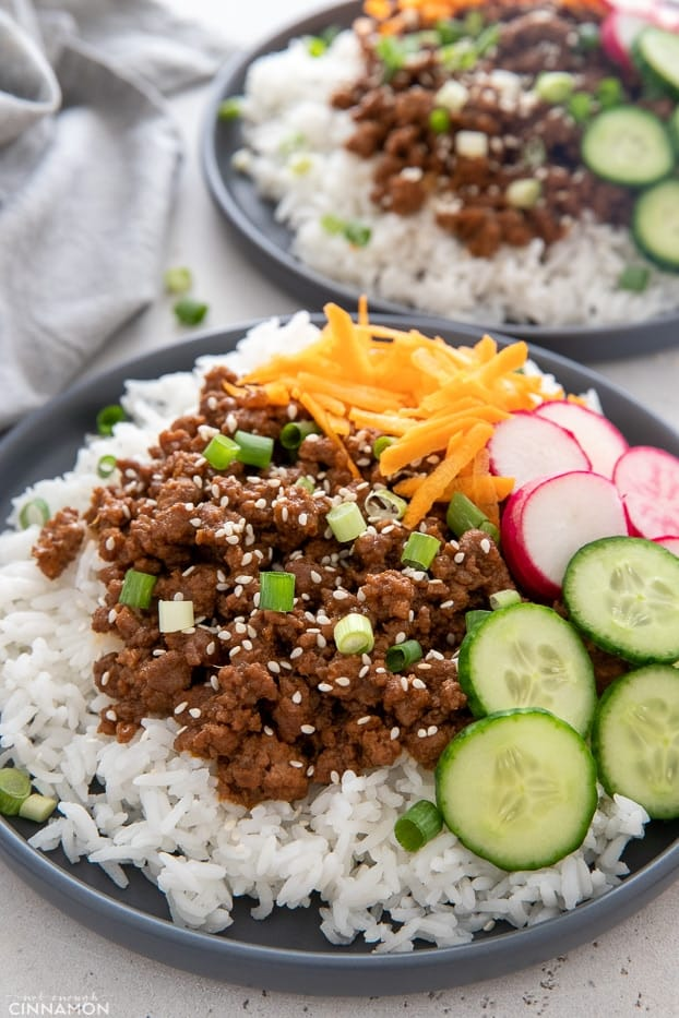 close up of Korean Beef Bowls sprinkled with sesame seeds