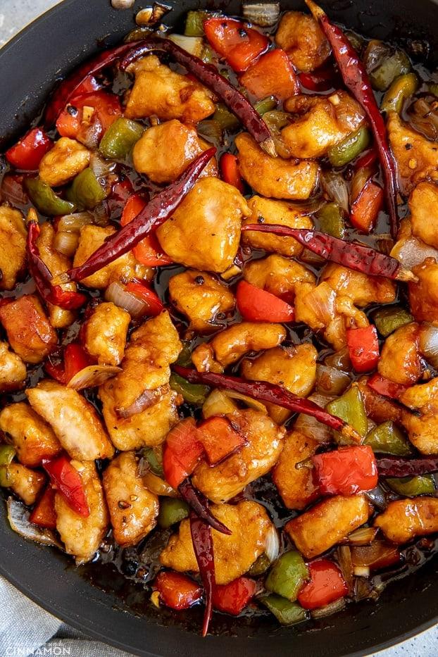 Chinese Szechuan Chicken Stir Fry in a black skillet