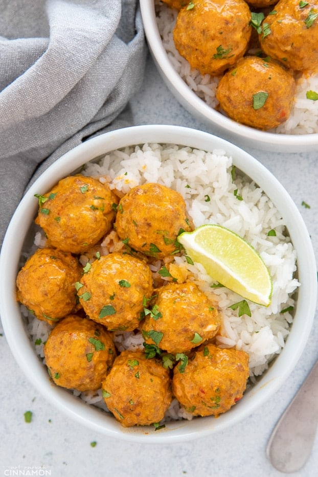 a plate with Thai coconut turkey meatballs curry served with rice