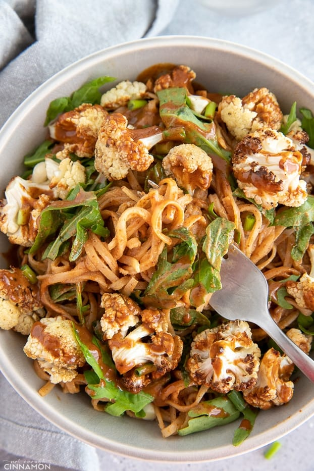overhead shot of a Almond Butter Noodle Bowl with Cauliflower and Arugula