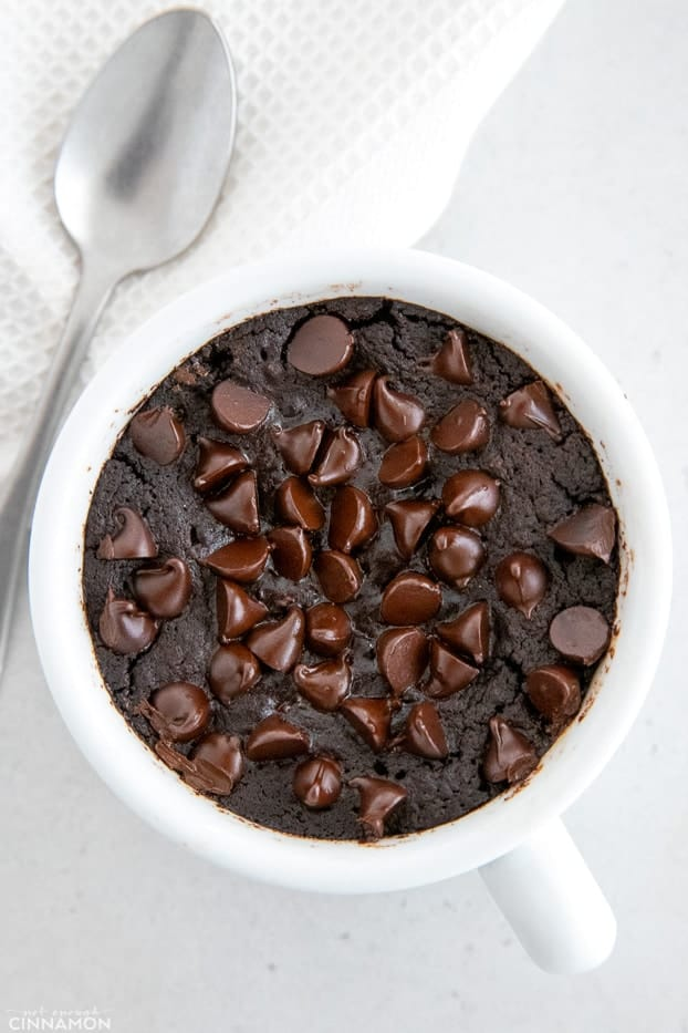 overhead shot of a vegan mug cake with chocolate chips