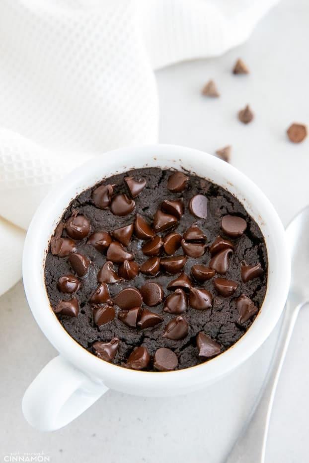 overhead shot of a vegan chocolate mug cake with chocolate chips