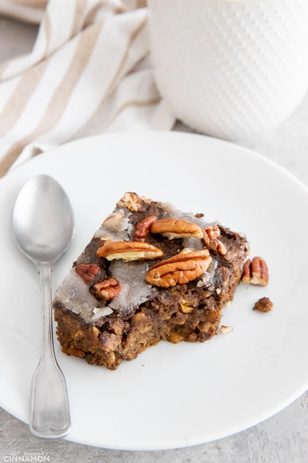 a half eaten square of vegan gingerbread baked oatmeal with a spoon on the side