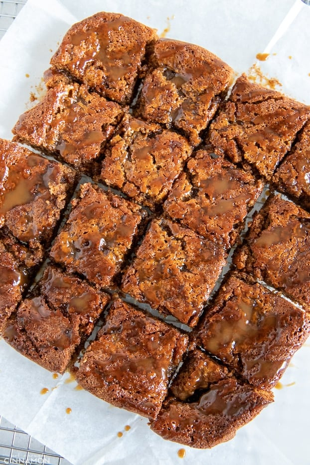 overhead shot of paleo healthy salted caramel blondies drizzled with coconut caramel sauce