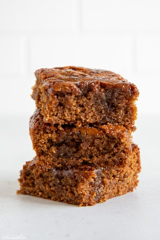 stacked healthy almond flour blondies drizzled with homemade dairyfree caramel