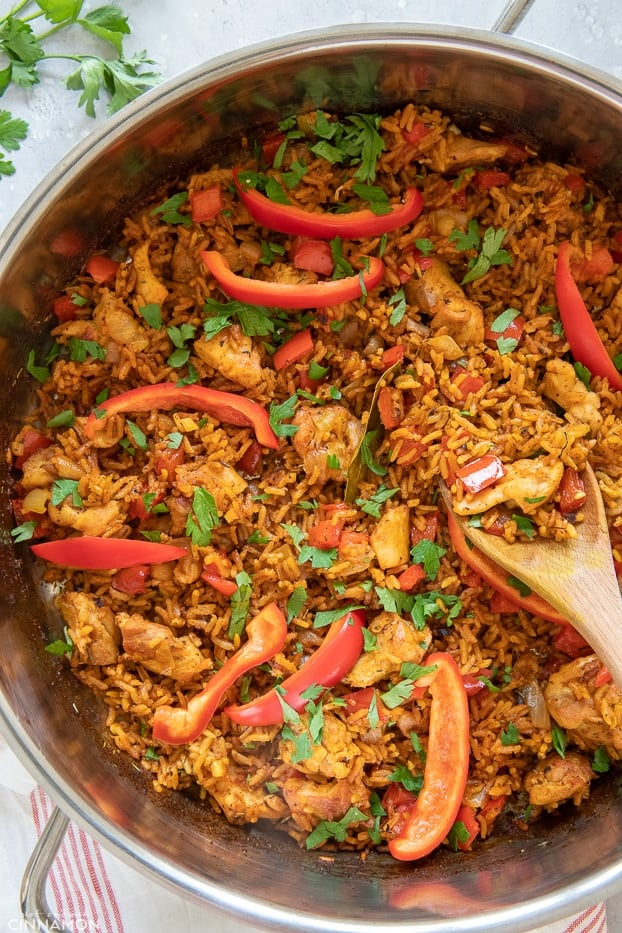 overhead shot of a pot with Jollof chicken and rice