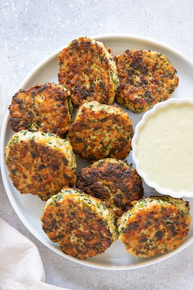paleo chicken poppers on a white plate served with a small dish with paleo ranch dip