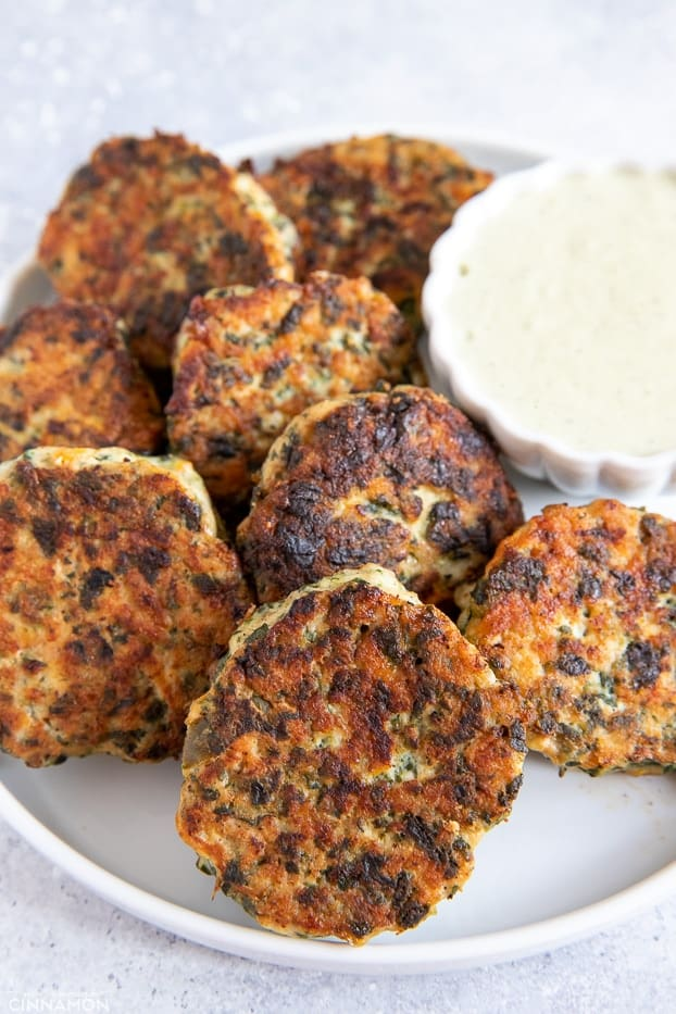 healthy paleo Ranch Chicken Poppers assembled around a small dish with paleo Ranch dip