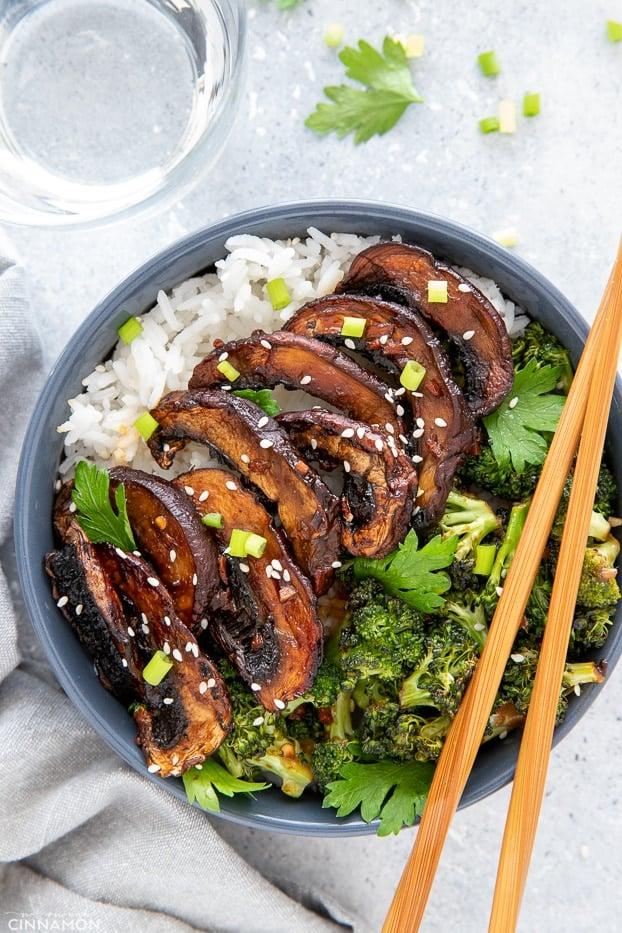 overhead shot of a teriyaki rice bowl topped with roasted teriyaki glazed portobello mushrooms