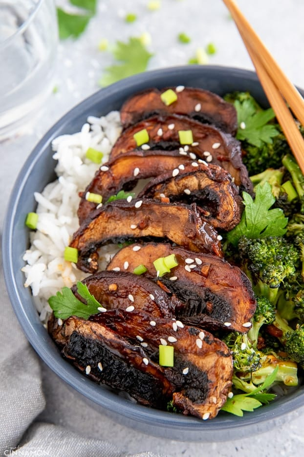 side view of vegan healthy mushroom rice bowl topped with teriyaki glazed mushrooms and broccoli