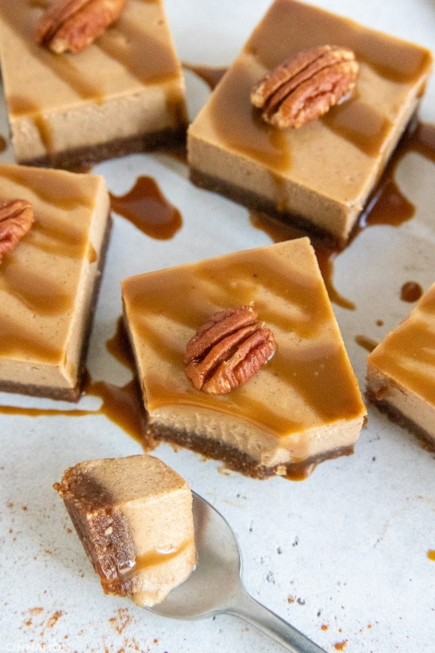 overhead shot of vegan chai latte cheesecake bars drizzled with coconut caramel