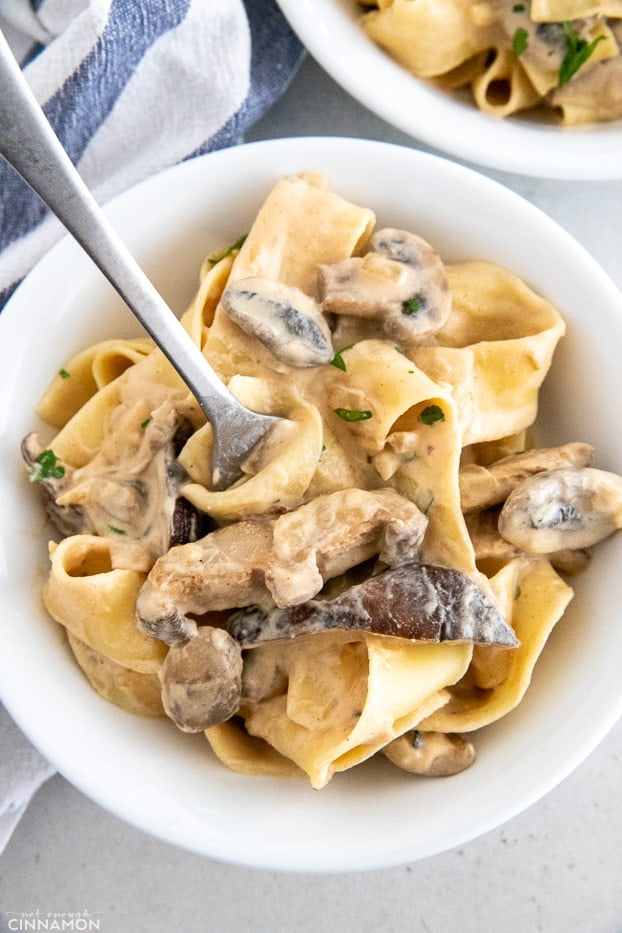 a plate of vegan mushroom stroganoff with a fork inserted