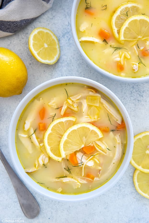 overhead shot of a two bowls of Greek Lemon Soup with Chicken and Orzo
