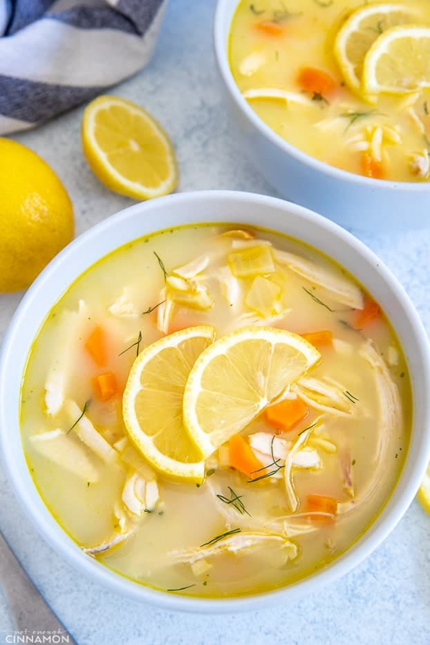 a bowl with Greek Lemon Soup with chicken and carrots added to it
