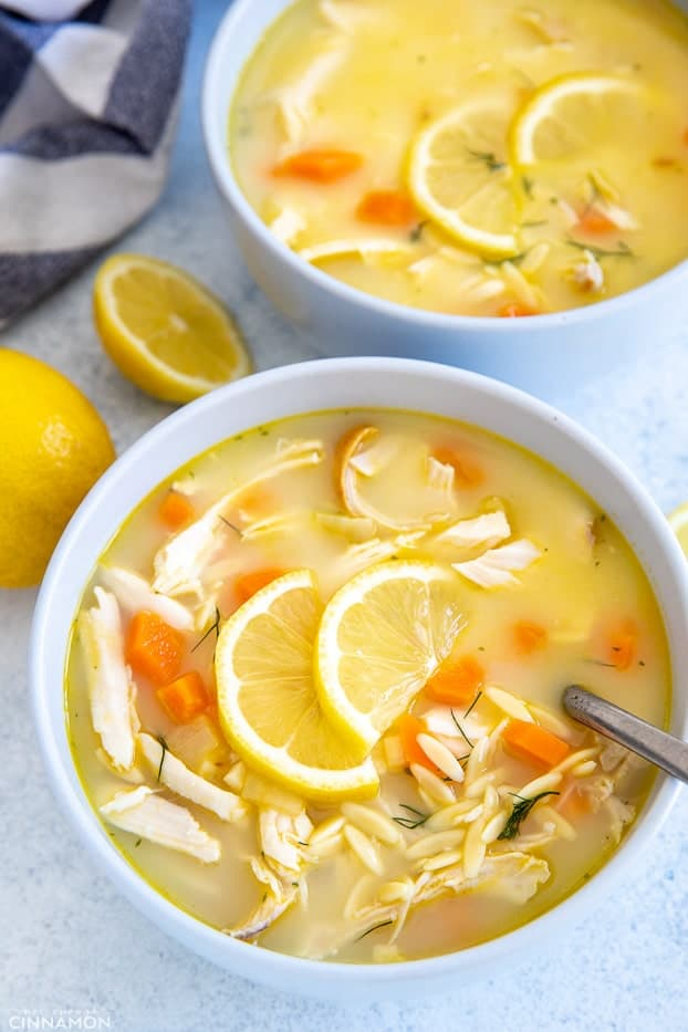 close up of a bowl of Greek Lemon Chicken Soup with a spoon