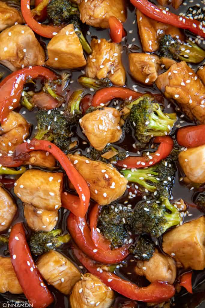 chicken breast, broccoli and bell pepper in sweet hot honey sauce sprinkled with sesame seeds