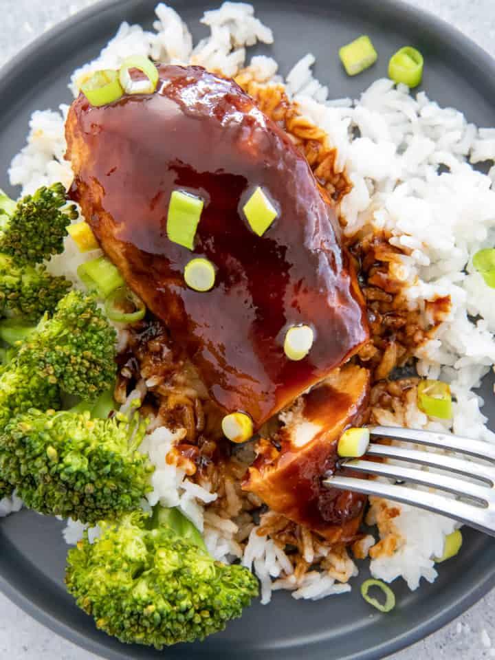 easy baked firecracker chicken served over rice