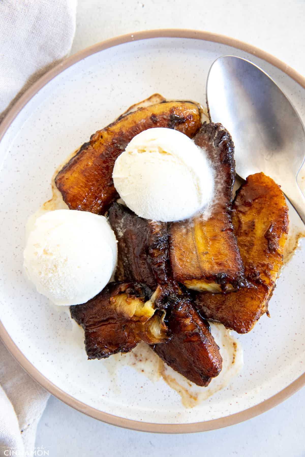 a plate with healthy banana foster topped with vanilla ice cream